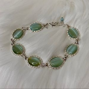 Avon silver bracelet with green gemstones